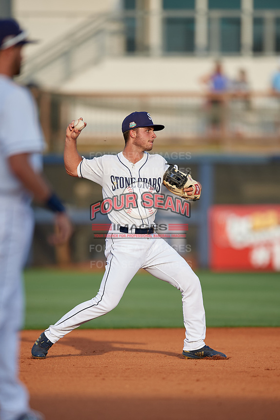 Charlotte Stone Crabs shortstop Tyler Frank (5) throws to first during a Florida State League game against the Fort Myers Miracle on April 6, 2019 at Charlotte Sports Park in Port Charlotte, Florida.  Fort Myers defeated Charlotte 7-4.  (Mike Janes/Four Seam Images)