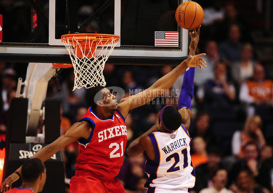 Dec. 28, 2011; Phoenix, AZ, USA; Phoenix Suns Hakim Warrick (right) takes a shot under pressure from Philadelphia 76ers forward Thaddeus Young at the US Airways Center. The 76ers defeated the Suns 103-83. Mandatory Credit: Mark J. Rebilas-USA TODAY Sports