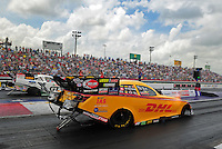 Apr. 29, 2012; Baytown, TX, USA: NHRA funny car driver Jeff Arend (near lane) races alongside Mike Neff during the Spring Nationals at Royal Purple Raceway. Mandatory Credit: Mark J. Rebilas-