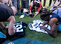 CHARLOTTE, NC - NOVEMBER 3: Christian McCaffrey #22 of the Carolina Panthers and Derrick Henry #22 of the Tennessee Titans sign their jerseys prior to trading them after the game during a game between Tennessee Titans and Carolina Panthers at Bank of America Stadium on November 3, 2019 in Charlotte, North Carolina.