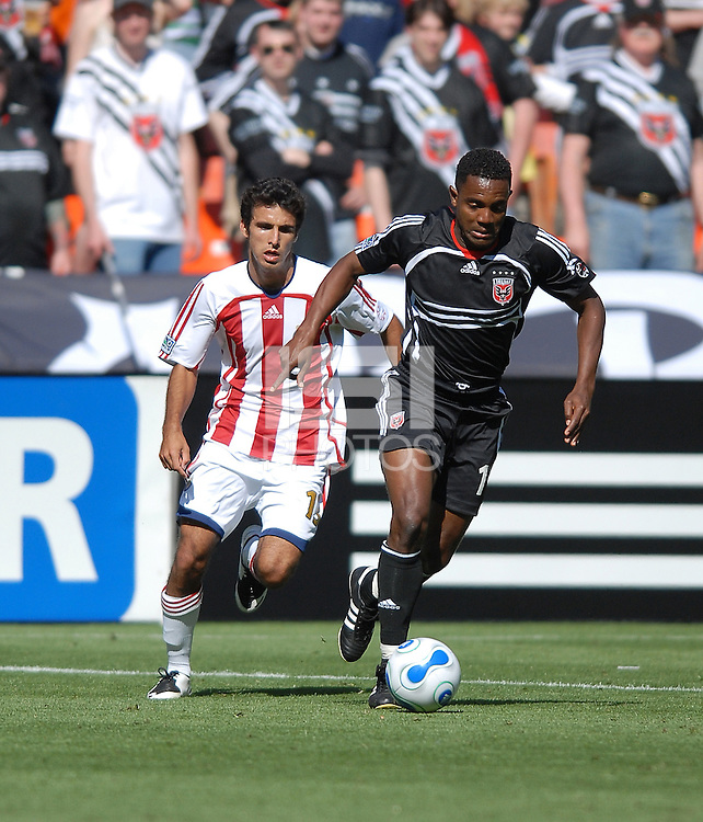 DC United forward Luciano Emilio (11) runs with the ball while being chased from behind by defender Alex Zotinca (23). DC United defeated Chivas USA 2-1, at RFK Stadium in Washington DC, Sunday May 6, 2007.