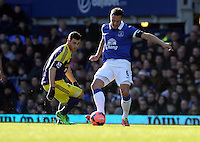 Pictured L-R: Alvaro Vazquez of Swansea and Phil Jakielka of Everton. Sunday 16 February 2014<br /> Re: FA Cup, Everton v Swansea City FC at Goodison Park, Liverpool, UK.