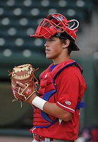 Catcher Logan Moore (10) of the Lakewood BlueClaws prior to a game against the Greenville Drive on the Drive's Opening Day, April 5, 2012, at Fluor Field at the West End in Greenville, South Carolina. (Tom Priddy/Four Seam Images)