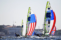 RIO DE JANEIRO, BRAZIL - AUGUST 13:  Thomas Barrows of the United States and Joe Morris of the United States and Benjamin Grez Ahrens of Chile and Cristobal Grez Ahrens of Chile compete in the Men's 49er class on Day 8 of the Rio 2016 Olympic Games at the Marina da Gloria on August 13, 2016 in Rio de Janeiro, Brazil.  (Photo by Laurence Griffiths/Getty Images)