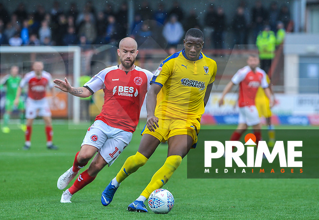 Fleetwood Town's forward Patrick Madden (17) and Wimbledon's defender Will Nightingale (5) during the Sky Bet League 1 match between Fleetwood Town and AFC Wimbledon at Highbury Stadium, Fleetwood, England on 10 August 2019. Photo by Stephen Buckley / PRiME Media Images.