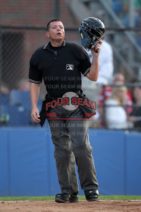Umpire Carlos Torres during a game at Dwyer Stadium in Batavia, New York;  July 15, 2010.  Photo By Mike Janes/Four Seam Images