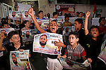 Palestinian children hold pictures of prisoner Mohammad Allan, allegedly being held in an Israeli jail, during a protest outside the Red Cross headquarter, in Gaza city on August 14, 2015. The Israeli military prosecutor intends to request court permission on Saturday to force-feed hunger striking prisoner Mohammad Allan, the Palestinian minister of prisoner affairs, Issa Qaraqe announced on Friday. Allan, a lawyer from the occupied West Bank city of Nablus, has been on hunger strike for at least 60 days in protest of his detention without charge or trial since his arrest in November. Photo by Ashraf Amra