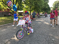 NWA Democrat-Gazette/SPENCER TIREY Camryn Hodge (8) rides her bike as she participates Wednesday, July 4, 2018, with other from her neighborhood in a 4th of July parade on Turtle Creek Drive in Rogers. Camryn who organized the event said she organized it because she wanted to show how much she loved America and wanted to make new friends.