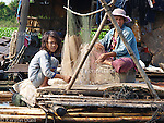 Floating Lives on the Tonle Sap - drying fishing nets and cleaning them from small fishes and plants. Children usually help with all tasks.