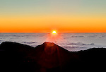 View from the rim of the crater of Mt. Haleakala (elev. 10,000 ft) at sunrise. Mt. Haleakala is a dormant volcano that forms the majority of the land area of Maui.