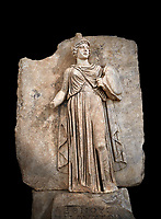 "Roman Sebasteion relief sculpture personifing a Balkan Warrior  Aphrodisias Museum, Aphrodisias, Turkey.  Against a black background.<br /> <br /> The relief figure personifies a Balkan Warrior tribe defeated by Tiberius in AD 6-8 before he became emperor. She wears a classical dress, cloak and helmet and carries a small shield and probably once a spear. A builder's inscription, ""Pirouston"", written above the shield, ensured the relief was put on the right base"
