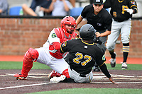 Johnson City catcher Irving Wilson (28) tags out a hard sliding Felix Vinicio as home plate umpire Josh Gilreath prepares to make the call during a game against the Bristol Pirates at TVA Credit Union Ballpark on June 23, 2017 in Johnson City, Tennessee. The Pirates defeated the Cardinals 4-3. (Tony Farlow/Four Seam Images)