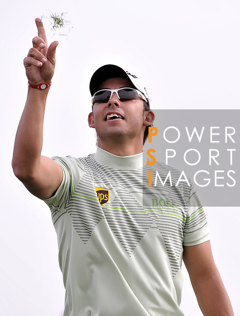 SUZHOU, CHINA - APRIL 17:  Pablo Larrazabal of Spain checks the wind direction on the 16th tee during the Round Three of the Volvo China Open on April 17, 2010 in Suzhou, China.  Photo by Victor Fraile / The Power of Sport Images
