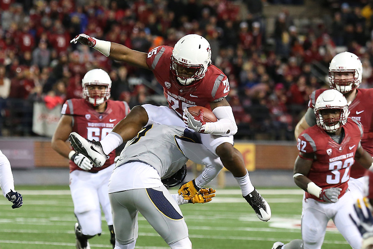 Jamal Morrow, Washington State running back, goes airborne to pick up yardage during the Cougars Pac-12 Conference game destruction of the Cal Bears, 56-21, on November 12, 2016, at Martin Stadium in Pullman, Washington.