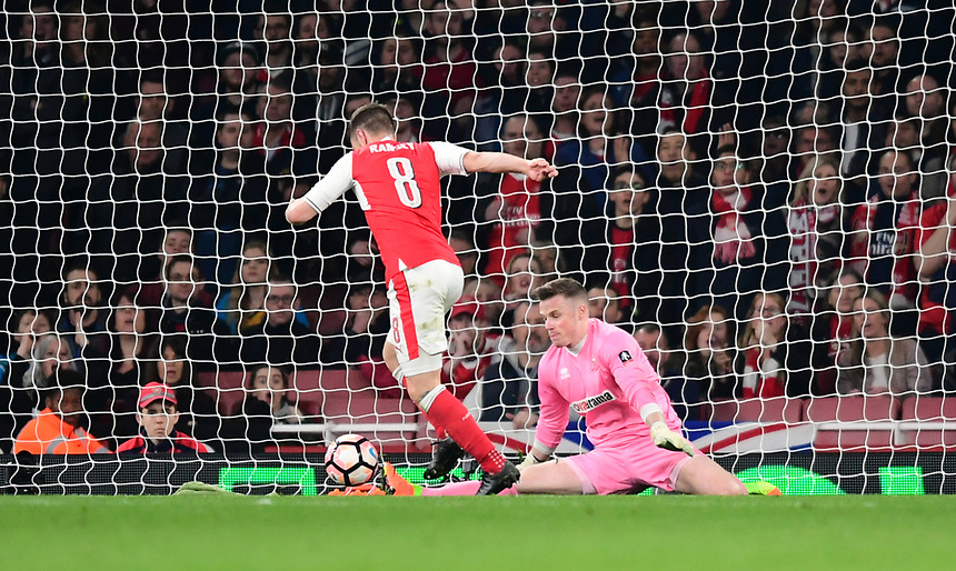 Arsenal's Aaron Ramsey goes round Lincoln City's Paul Farman to score his sides fifth goal <br /> <br /> Photographer Chris Vaughan/CameraSport<br /> <br /> The Emirates FA Cup Quarter-Final - Arsenal v Lincoln City - Saturday 11th March 2017 - The Emirates - London<br />  <br /> World Copyright &copy; 2017 CameraSport. All rights reserved. 43 Linden Ave. Countesthorpe. Leicester. England. LE8 5PG - Tel: +44 (0) 116 277 4147 - admin@camerasport.com - www.camerasport.com