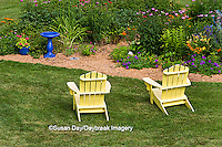 63821-20007 Yellow Adirondack chairs near flower garden with blue birdbath, Marion Co., IL