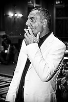 Famous Stylist/Designer/Mogul Christian Audigier consuming a smoke before the interview