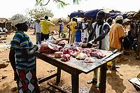 BURKINA FASO , Fada N´Gourma, village TINDANGOU, rural market, meat seller