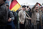 A man holding a German flag marching through the streets of Berlin during a demonstration by the Alternative für Deutschland (AfD) political party. Around 5000 supporters of the AfD took part in the march and rally calling on German Chancellor Angela Merkel to halt the influx of refugees into the country. Around one million refugees from the Middle East and north Africa arrived in Germany during 2015, 50,000 of whom came to Berlin.