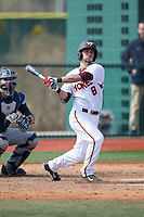 Alex Perez (8) of the Virginia Tech Hokies follows through on his swing against the Toledo Rockets at The Ripken Experience on February 28, 2015 in Myrtle Beach, South Carolina.  The Hokies defeated the Rockets 1-0 in 10 innings.  (Brian Westerholt/Four Seam Images)