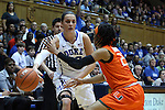 18 January 2015: Duke's Rebecca Greenwell (left) bounces  the ball past Miami's Adrienne Motley (right). The Duke University Blue Devils hosted the University of Miami Hurricanes at Cameron Indoor Stadium in Durham, North Carolina in a 2014-15 NCAA Division I Women's Basketball game. Duke won the game 68-53.