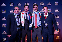 #4 overall pick Steve Neumann and #11 overall pick Patrick Mullins of the New England Revolution stand with head coach Jay Heaps during the MLS SuperDraft at the Pennsylvania Convention Center in Philadelphia, PA, on January 16, 2014.