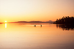 Sea kayakers, Sunrise, Haro Strait, San Juan Islands, Mount Baker, Pacific Northwest, Washington State, British Columbia, Gulf Islands (foreground), Canada