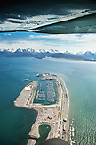USA, Alaska, Homer, an aerial view of the Homer Spit and marina, Land's End, Kachemak Bay with the Kenai mountains in the distance