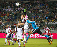 CARSON, CA - October 20, 2012: Colorado Rapids midfielder Jeff Larentowicz (4) and goalie Steward Ceus (31) during the Chivas USA vs Colorado Rapids match at the Home Depot Center in Carson, California. Final score, Chivas USA 0, Colorado Rapids 2.