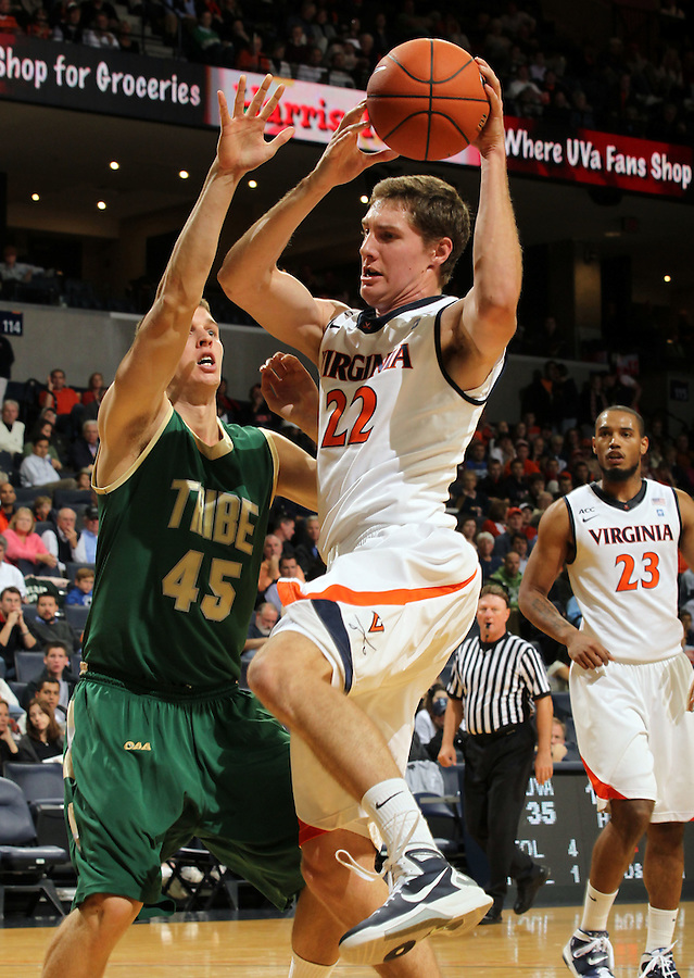 Nov. 12, 2010; Charlottesville, VA, USA; Virginia Cavaliers forward Will Sherrill (22) grabs a rebound in front of William & Mary Tribe forward Marcus Kitts (45) during the game at the John Paul Jones Arena. Virginia won 76-52.  Mandatory Credit: Andrew Shurtleff