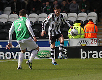 Kenny McLean being closed down by Matthew Doherty in the St Mirren v Hibernian Clydesdale Bank Scottish Premier League match played at St Mirren Park, Paisley on 29.4.12.