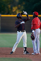 AZL Giants Black Sandro Fabian (14) celebrates in front of Cristian Gomez (37) after hitting a double during a rehab assignment in an Arizona League game against the AZL Angels at the Giants Baseball Complex on June 21, 2019 in Scottsdale, Arizona. AZL Angels defeated AZL Giants Black 6-3. (Zachary Lucy/Four Seam Images)