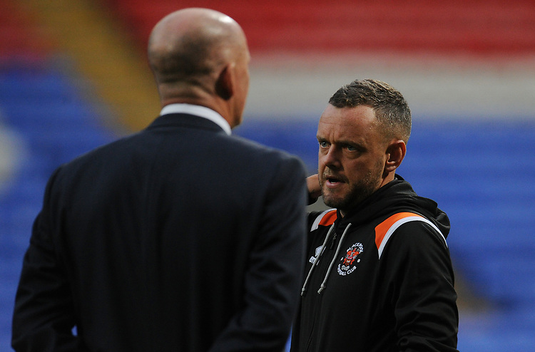 Blackpool's Jay Spearing chats with Simon Grayson <br /> <br /> Photographer Kevin Barnes/CameraSport<br /> <br /> The EFL Sky Bet League One - Bolton Wanderers v Blackpool - Monday 7th October 2019 - University of Bolton Stadium - Bolton<br /> <br /> World Copyright © 2019 CameraSport. All rights reserved. 43 Linden Ave. Countesthorpe. Leicester. England. LE8 5PG - Tel: +44 (0) 116 277 4147 - admin@camerasport.com - www.camerasport.com