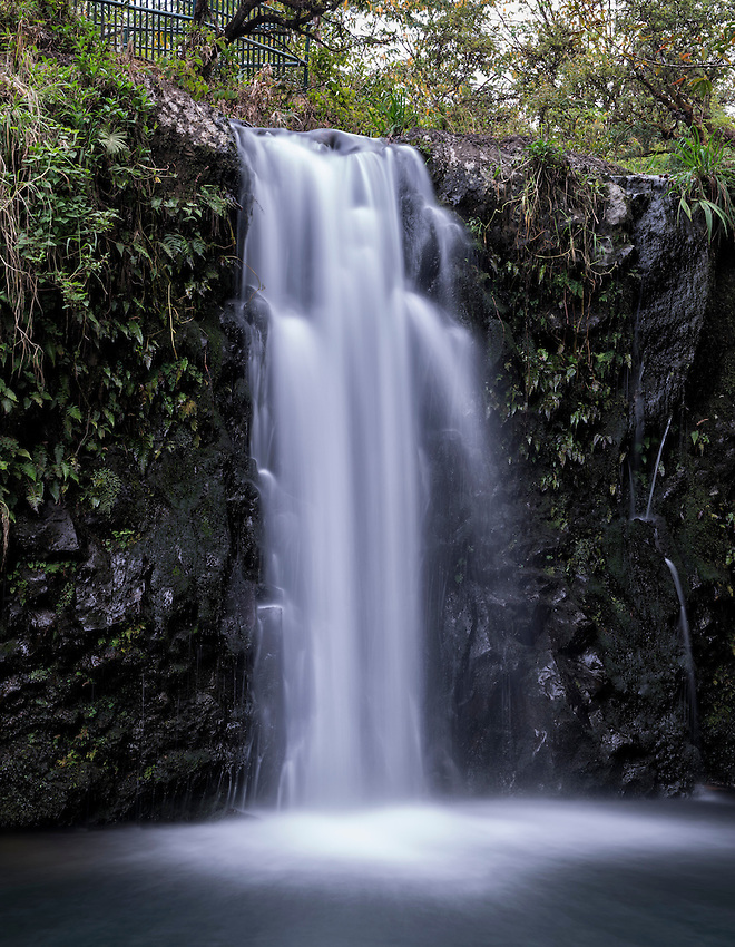 The lower waterfall at Pua'a Ka'a State Wayside Park, located near the Mile 22 marker on the Hana Highway, Maui