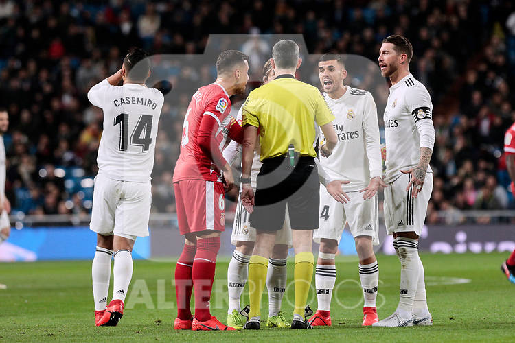 Real Madrid's Dani Ceballos have words with the referee during Copa del Rey match between Real Madrid and Girona FC at Santiago Bernabeu Stadium in Madrid, Spain. January 24, 2019. (ALTERPHOTOS/A. Perez Meca)
