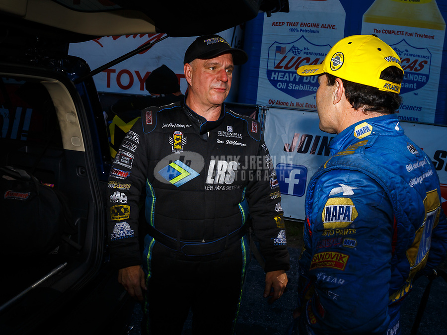May 7, 2017; Commerce, GA, USA; NHRA funny car driver Tim Wilkerson (left) talks with race winner Ron Capps during the Southern Nationals at Atlanta Dragway. Mandatory Credit: Mark J. Rebilas-USA TODAY Sports
