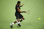 SHANGHAI, CHINA - OCTOBER 13:  Gael Monfils of France returns a shot to his compatriot Paul-Henri Mathieu during day three of 2009 Shanghai ATP Masters 1000 at the Qi Zhong Tennis Centre in Shanghai. Photo by Victor Fraile / The Power of Sport Images