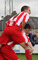 Robert Jones climbs on Jamie McHarrie after his goal in the Huntly v Wigtown & Bladnoch William Hill Scottish Cup 1st Round match, at Christie Park, Huntly on 25.8.12.