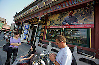 Liulichang art and antiquities street. Rongbao Zhai art shop. Chairman Mao as artist.