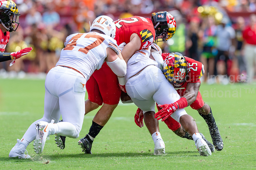 Landover, MD - September 1, 2018: Maryland Terrapins defensive back Antoine Brooks Jr. (25) makes a tackle during game between Maryland and No. 23 ranked Texas at FedEx Field in Landover, MD. The Terrapins upset the Longhorns in back to back season openers with a 34-29 win. (Photo by Phillip Peters/Media Images International)