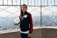 U.S. women national team midfielder Carli Lloyd poses for a photo on the observation deck of the Empire State Building during the centennial celebration of U. S. Soccer in New York, NY, on April 05, 2013.