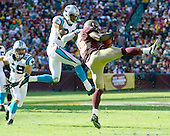 Washington Redskins wide receiver Joshua Morgan (15) makes a catch against Carolina Panthers corner back Josh Norman (24) in second quarter action at FedEx Field in Landover, Maryland on Sunday, November 4, 2012..Credit: Ron Sachs / CNP