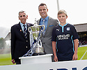 The 2013 / 2014 Championship trophy is presented to the crowds at Dens Park, by Blair Kinmont (right) and club legends Gavin Rae and Pat Liney (left).