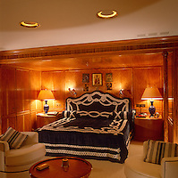 Bedding with a nautical theme brings a touch of fun to the master bedroom of this luxury 80's yacht