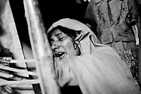 The mother of 15-year-old Sultan Ahmed grieves over the lifeless body of her son.  He was sick for weeks and died on December 20th, 2009 from typhoid. (2009)