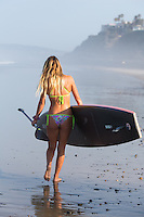 Blonde Girl Walking on the Beach with Stand Up Paddle Board in San Clemente