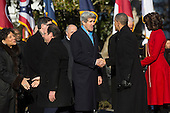 United States President Barack Obama, center right, shakes hands with U.S. Secretary of State John Kerry during an arrival ceremony on the South Lawn of the White House in Washington, D.C., U.S., on Tuesday, Feb. 11, 2014. <br /> Credit: Andrew Harrer / Pool via CNP