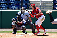 Clearwater Threshers shortstop Freddy Galvis (13) at bat in front of catcher catcher Peter O'Brien (24) and umpire Brennan Miller during a game against the Tampa Yankees on April 9, 2014 at Bright House Field in Clearwater, Florida.  Tampa defeated Clearwater 5-3.  (Mike Janes/Four Seam Images)