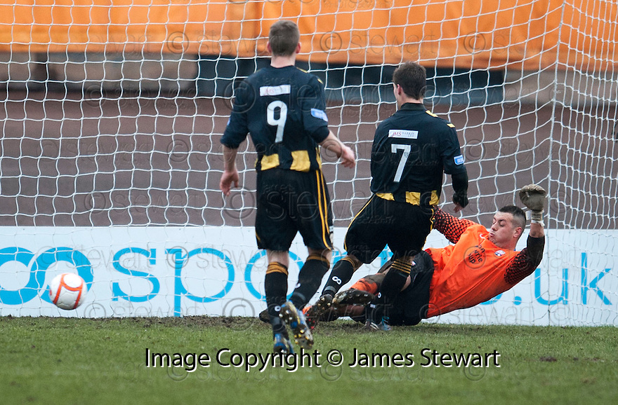 Berwick's Fraser McLaren (7) get to the ball first to score their and his third goal after Montrose keeper John Gibson saved his penalty.