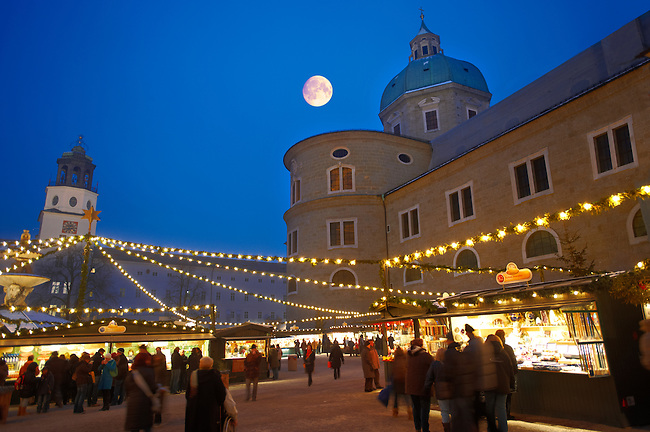 Christmas market stalls at night with Christams lights  at Satlzburgh market - Austria